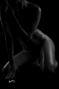 Black & white nude portrait Photograph of a model with a Black background